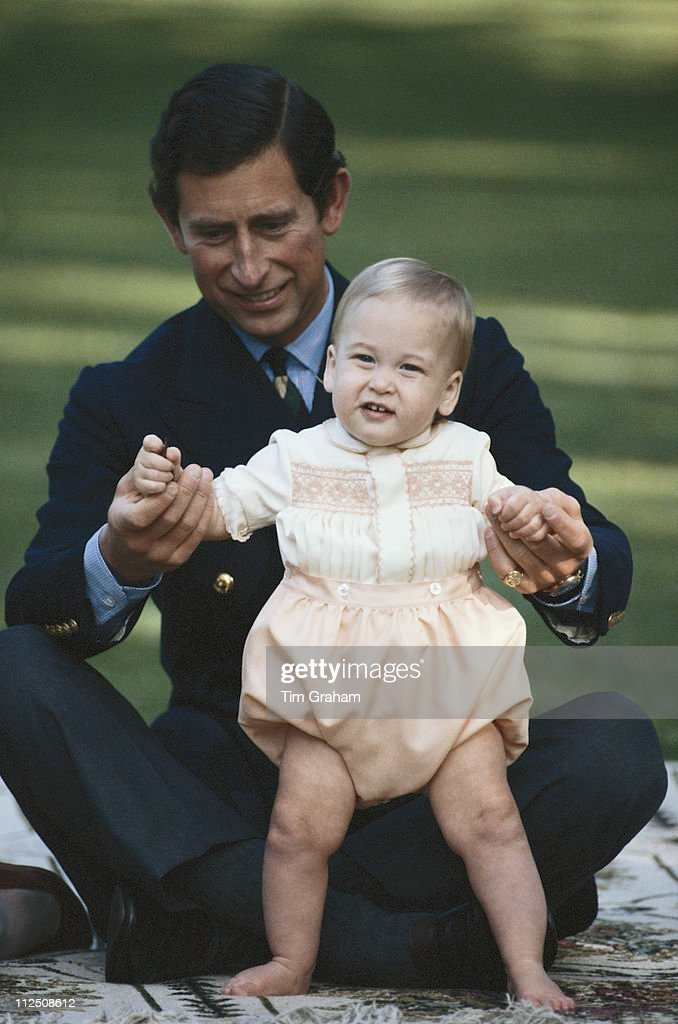 Prince Charles sits cross legged with his son Prince William during a photocall at Government House in Auckland during their 1983 official visit to...