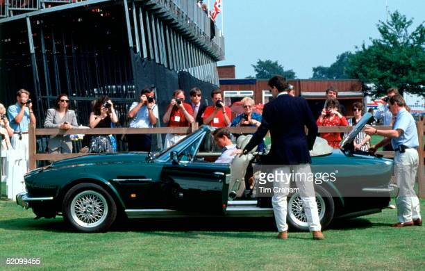 Prince Charles Sitting In His Aston Martin V8 Volante Convertible Car After Attending Cartier International Polo Day Members Of His Staff Are Police...