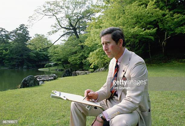 Prince Charles sketching in the gardens of Omiya Palace during a break in his official tour of Japan