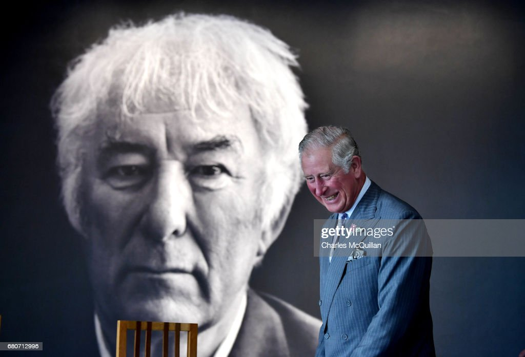 HRH Prince Charles smiles as he walks past a portrait of the late Seamus Heaney during his visit to Seamus Heaney Home Place along with the Duchess of Cornwall on May 9, 2017 in Bellaghy, Northern Ireland. The arts and literary centre in Heaney's home town celebrates the late Poet Laureate's life and work via an interactive exhibition, aretfacts and manuscripts. The Royal couple are on a two day visit to Northern Ireland.