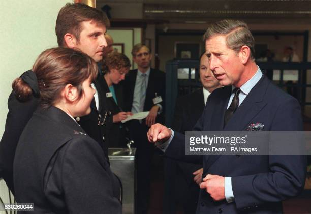 Prince Charles speaks to PC Jennifer McKenzie and PC Gavin Cerasale of Notting Hill Police Station at St Mary's Hospital in Paddington London The two...