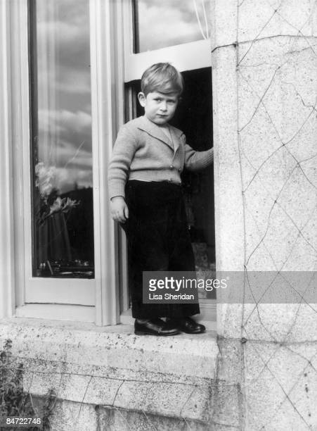 Prince Charles stands on a windowsill at Balmoral Castle in Scotland 1953