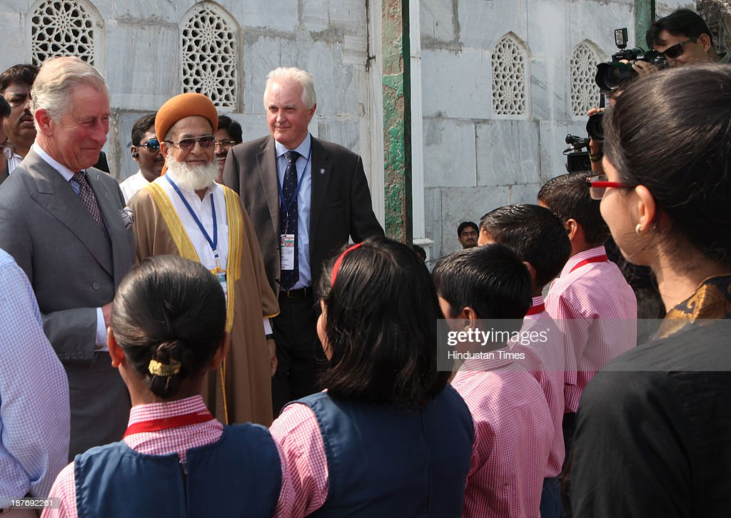 Prince Charles talks with the school children during his visit at the Haji Ali Dargah, Mahalaxmi on November 11, 2013 in Mumbai, India. Haji Ali shrine is the resting abode of the Muslim saint Pir Haji Ali Shah Bukhari and is situated a few hundred meters ahead of the shoreline of the Arabian Sea. Prince Charles is on a nine-day-visit to the country with his wife, the Duchess of Cornwall, Camilla before leaving for Sri Lanka to attend the Commonwealth Heads of Government Meeting in Colombo.