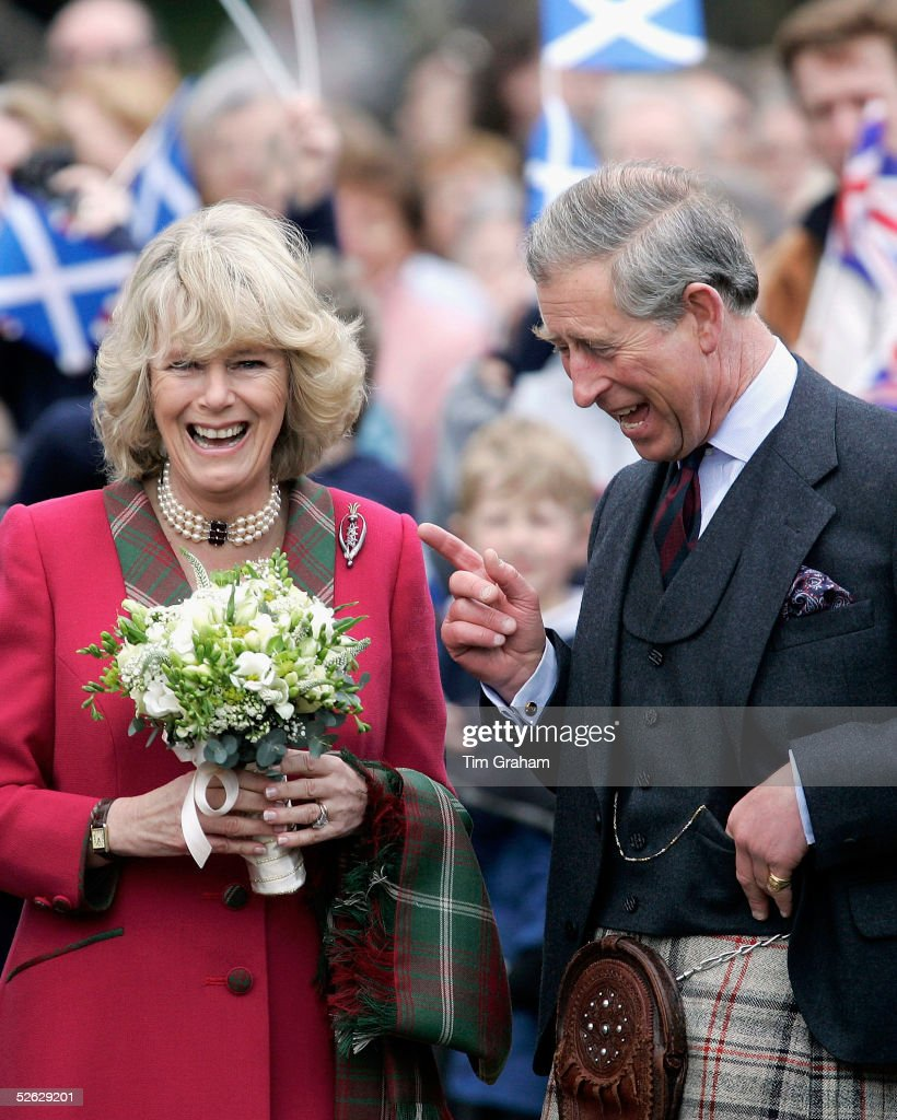 Prince Charles, the Prince of Wales, and his wife Camilla, the Duchess of Cornwall, in their role as the Duke and Duchess of Rothesay, take time out from their honeymoon to undertake their first joint official engagement opening Monaltrie Park children's playground in Ballater near Balmoral on April 14, 2005 in Aberdeenshire, Scotland.