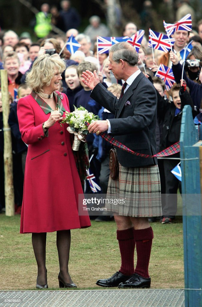 Prince Charles, the Prince of Wales, and his wife Camilla, the Duchess of Cornwall, in their role as the Duke and Duchess of Rothesay, take time out from their honeymoon at Birkhall on the Queen's Aberdeenshire estate, to undertake their first joint official engagement opening Monaltrie Park children's playground in Ballater near Balmoral on April 14, 2005 in Aberdeenshire, Scotland.