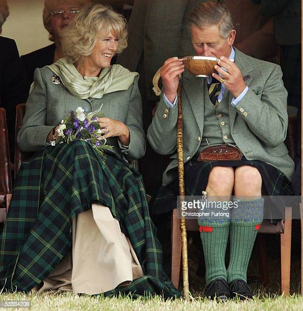 Prince Charles the Prince of Wales and his wife Camilla the Duchess of Cornwall in their role as the Duke and Duchess of Rothesay enjoy a drink of...
