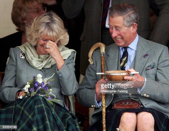 Prince Charles the Prince of Wales and his wife Camilla the Duchess of Cornwall in their role as the Duke and Duchess of Rothesay drink whisky from a...