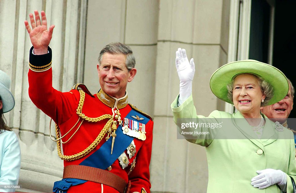 Prince Charles, The Prince of Wales and Queen Elizabeth II wave to onlookers during the Trooping of the Colour ceremony at Buckingham Palace on June 15, 2002 in London, England.
