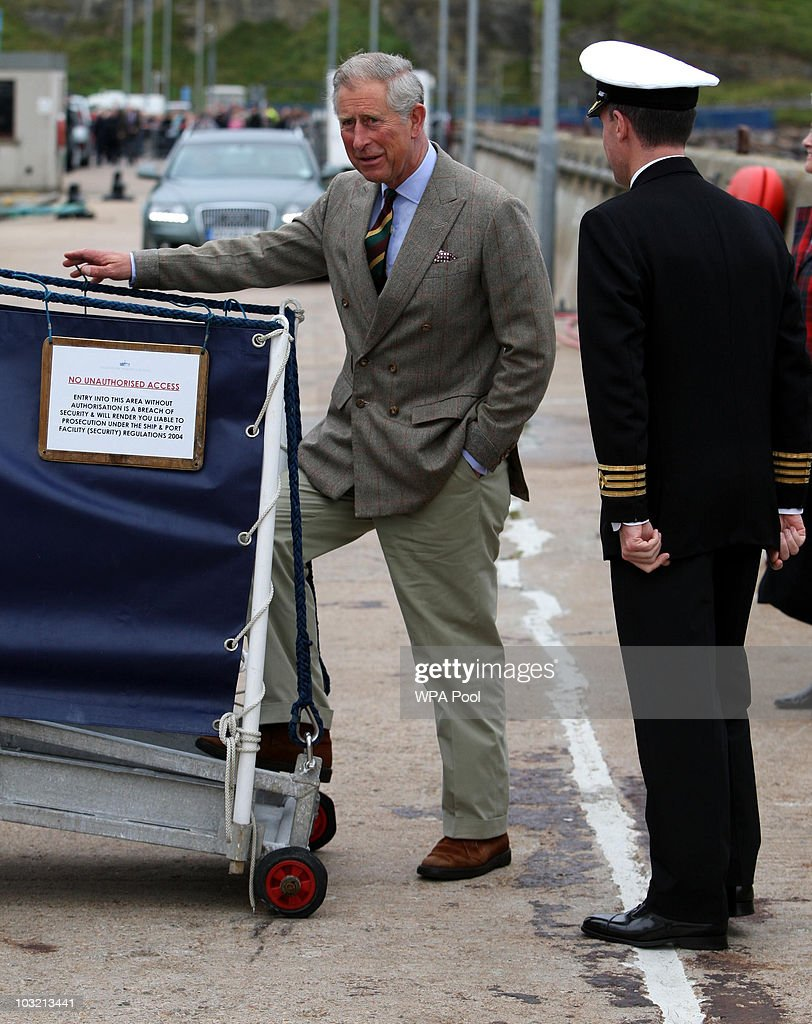Prince Charles, The Prince of Wales arrives to greet Queen Elizabeth II as they disembark the Hebridean Princess boat after a family holiday around the Western Isles of Scotland, on August 02, 2010 in Scrabster, Scotland.