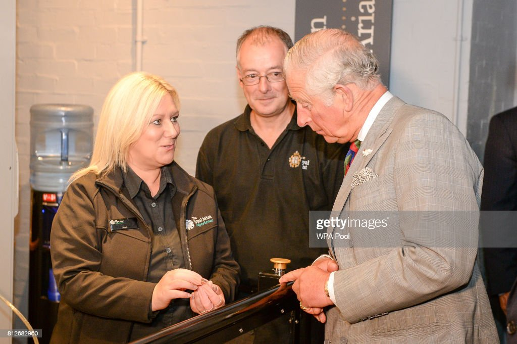 Prince Charles, The Prince of Wales is shown the new commemorative £5 coin, celebrating the Duke of Edinburgh's lifetime in the public service, that he struck himself, by Coin Setter Meril Williams (left), during a tour of The Royal Mint's visitor centreon July 11, 2017 in Heol-Y-Sarn, Wales.