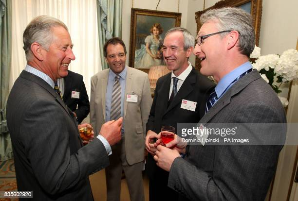 Prince Charles The Prince of Wales speaks to Paul Davies from the Eden Housing Association Andrew Smith from the Oxfordshire Citizens Housing...