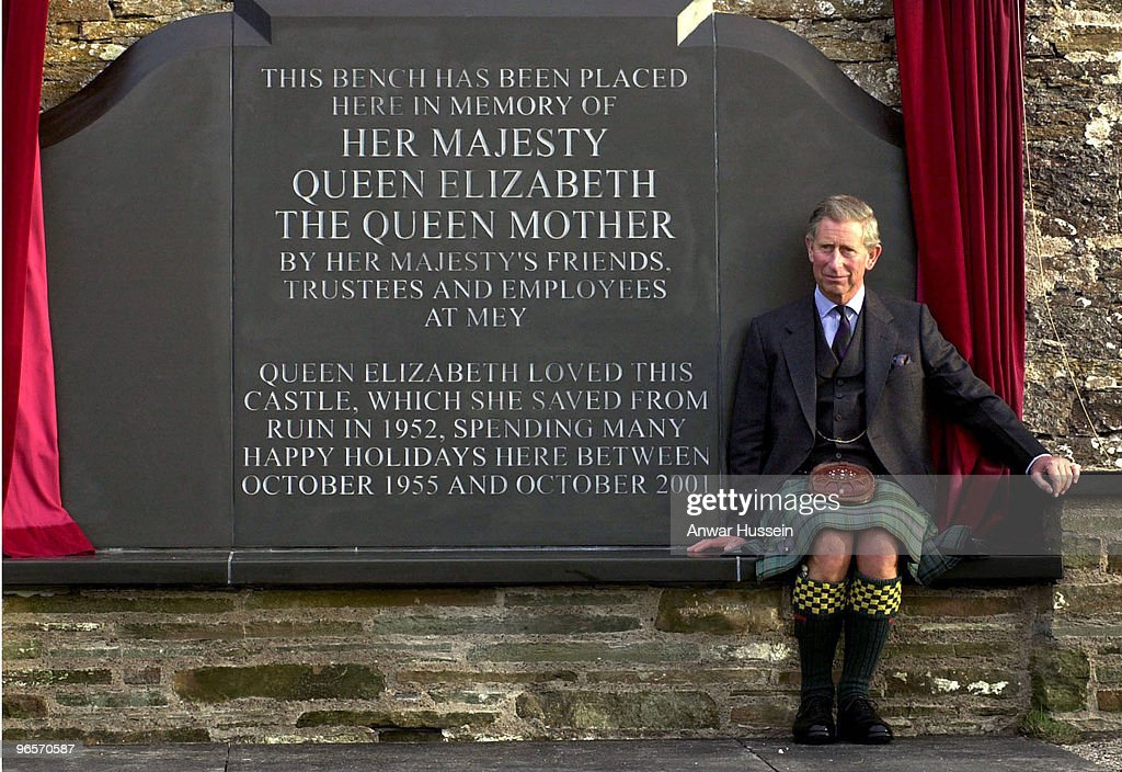 Prince Charles unviels a seat in memory of the Queen Mother by the walls of the Castle of Mey on August 9th 2002