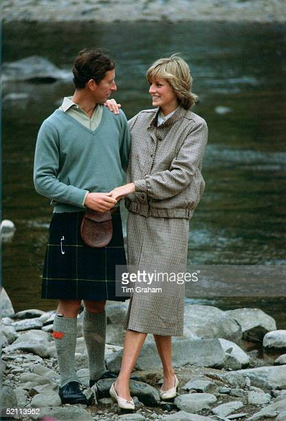 Prince Charles With His Arm Around His Wife Princess Diana As They Hold Hands During A Honeymoon Photocall By The River Dee The Princess Is Wearing A...