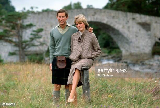 Prince Charles With His Arm Around His Wife Princess Diana During A Honeymoon Photocall By The River Dee The Princess Is Wearing A Suit Designed By...