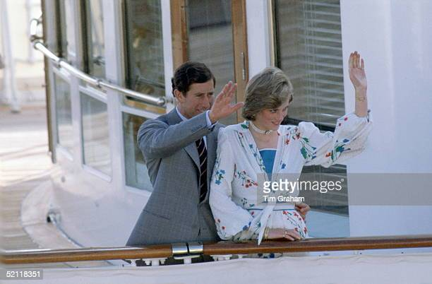Prince Charles With His Arm Around Princess Diana At The Rail Of The Royal Yacht Britannia At The Start Of Their Honeymoon Cruiseher Outfit Designed...