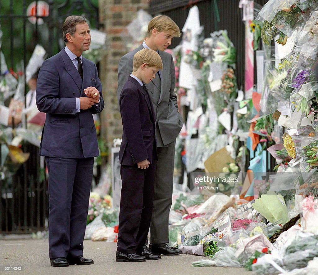 Prince Charles With Prince William & Prince Harry Looking At The Floral Tributes At Kensington Palace After The Death Of Their Mother