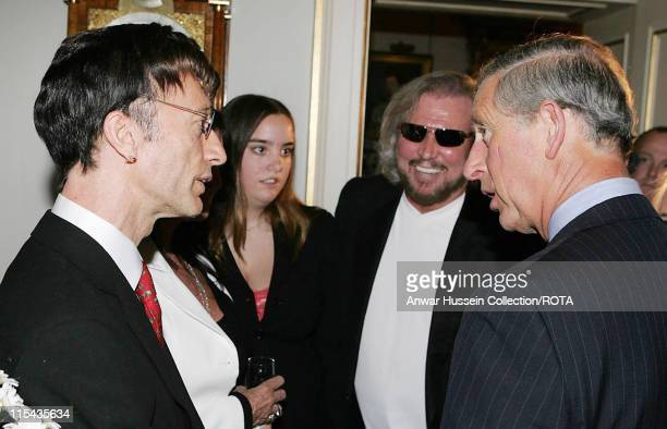 Prince CharlesPrince of Wales meets Robin Gibb and Barry Gibb at a reception at Clarence House for those lending their support to Saturday's...