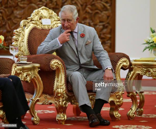 Prince CharlesThe Prince of Wales awaits the arrival of His Majesty The Yang diPertuan Agong XV Sultan Muhammad V at his official residence Istana...