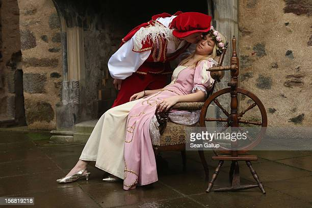 Prince Charming actually actor Andreas Richhardt kisses Sleeping Beauty played by actress Elisabeth Knoche to wake her from her 100year sleep at...
