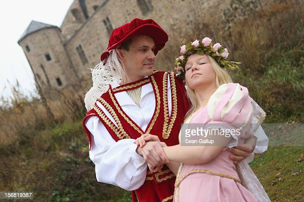 Prince Charming actually actor Andreas Richhardt supports Sleeping Beauty played by actress Elisabeth Knoche at Sababurg Palace on November 18 2012...