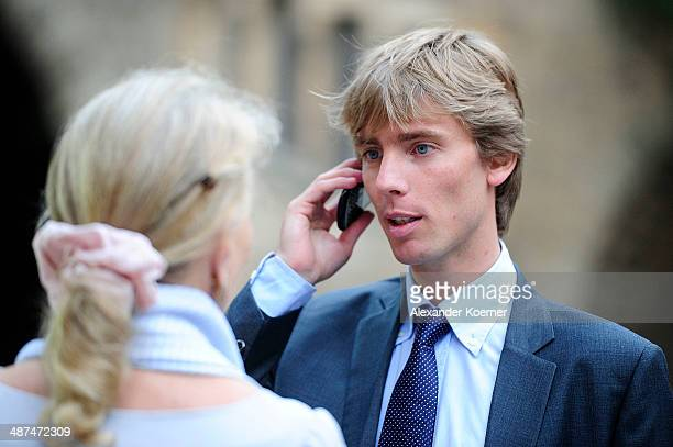 Prince Christian of Hanover is pictured talking on his phone during the official opening of the 'Der Weg zur Krone Das Koenigreich Hannover und seine...