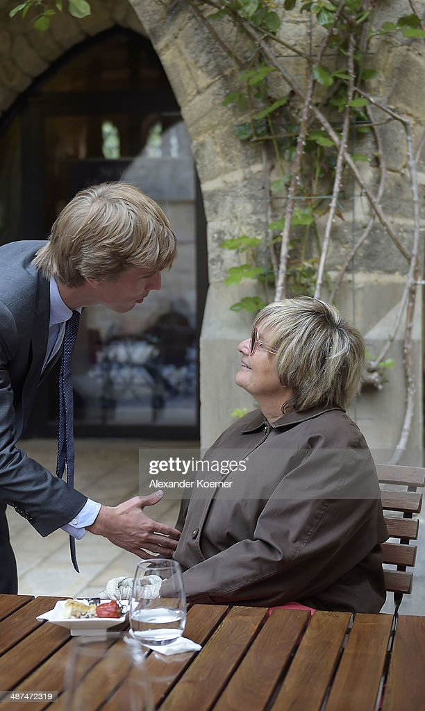 Prince Christian of Hanover is pictured talking to Countess Gloria von Thurn und Taxis during the official opening of the 'Der Weg zur Krone Das...