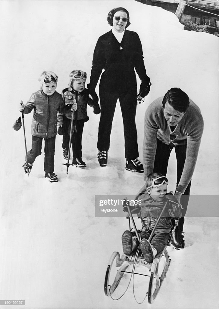 Prince Claus of the Netherlands (1926 - 2002) with Queen Beatrix and their sons Willem-Alexander, Prince of Orange (on toboggan), Prince Friso and Prince Constantijn, during a holiday in Lech, Austria, 9th March 1972.