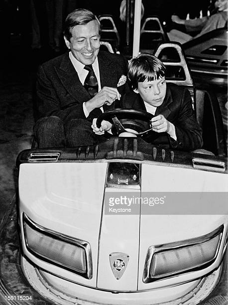 Prince Claus the husband of Queen Beatrix of the Netherlands and his son Prince Constantijn try out a dodgem car in the town of Breda Netherlands...