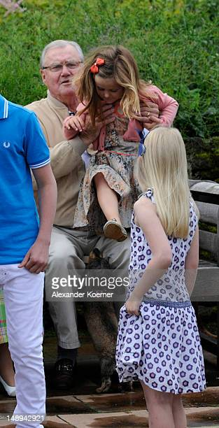 Prince Consort Henrik of Denmark and Princess Isabella pose during a photocall for the Royal Danish family at their summer residence of Grasten Slot...