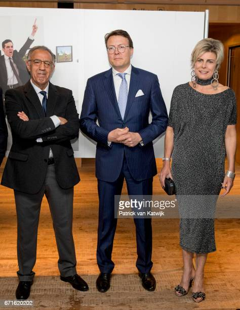 Prince Constantijn of The Netherlands and Princess Laurentien of The Netherlands with Turkish AP photographer Burhan Ozbilici pose with the World...