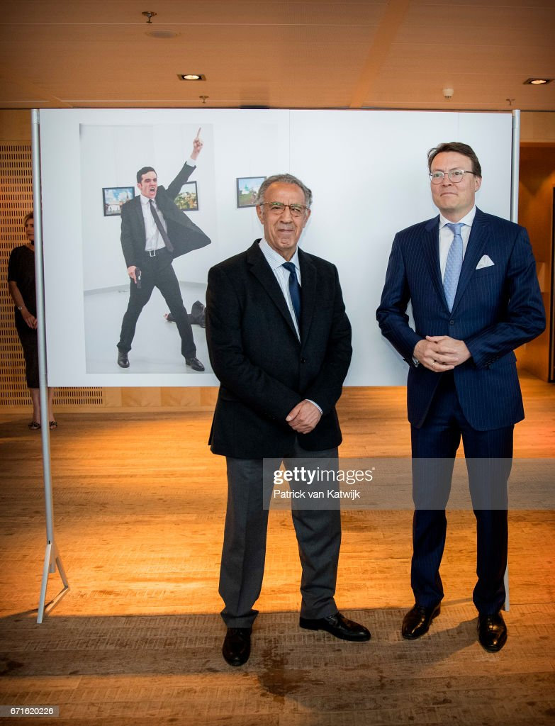 Prince Constantijn of The Netherlands with Turkish AP photographer Burhan Ozbilici pose with the World Press Photo winning picture of the murder of ambassador Andrey Karlov in Ankara 19 december 2016 during the World Press Photo Award ceremony on April 22, 2017 in Amsterdam, Netherlands.