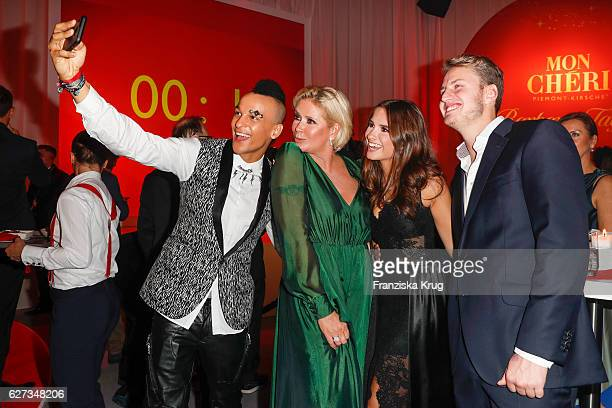 Prince Damien Claudia Effenberg with her daugter Lucia Strunz and their boyfriend Gabo during the Mon Cheri Barbara Tag at Postpalast on December 2...