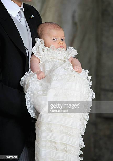 Prince Daniel of Sweden holds his daughter and new Swedish heir to the throne Princess Estelle Silvia Ewa Mary of Sweden at The Royal Palace on May...