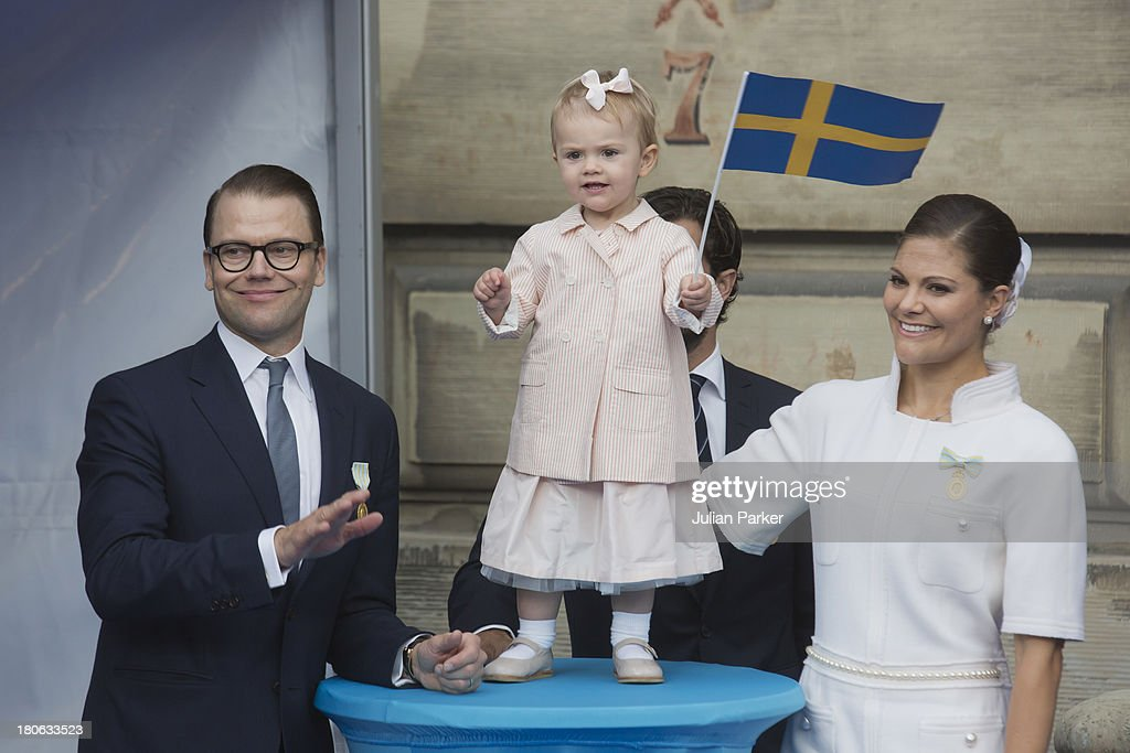 Prince Daniel of Sweden, <a gi-track='captionPersonalityLinkClicked' href=/galleries/search?phrase=Princess+Estelle&family=editorial&specificpeople=8948207 ng-click='$event.stopPropagation()'>Princess Estelle</a> of Sweden and <a gi-track='captionPersonalityLinkClicked' href=/galleries/search?phrase=Crown+Princess+Victoria+of+Sweden&family=editorial&specificpeople=160266 ng-click='$event.stopPropagation()'>Crown Princess Victoria of Sweden</a> attend the city of Stockholm's celebrations for King Carl Gustaf's 40th jubilee at the The Royal Palace on September 15, 2013 in Stockholm, Sweden.