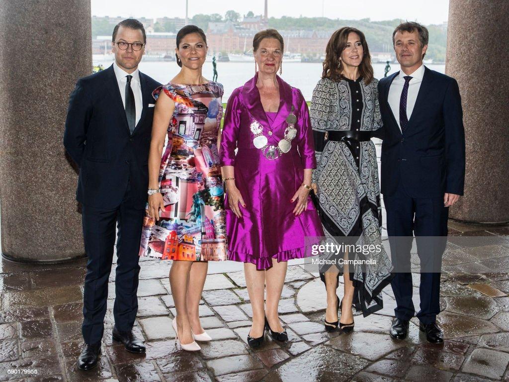 Prince Daniel of Sweden, Princess Victoria of Sweden, Eva-Louise Erlandsson Slorach, Prince Frederik of Denmark, and Princess Mary of Denmark arrive Stockholm city hall for an official dinner on May 30, 2017 in Stockholm, Sweden.