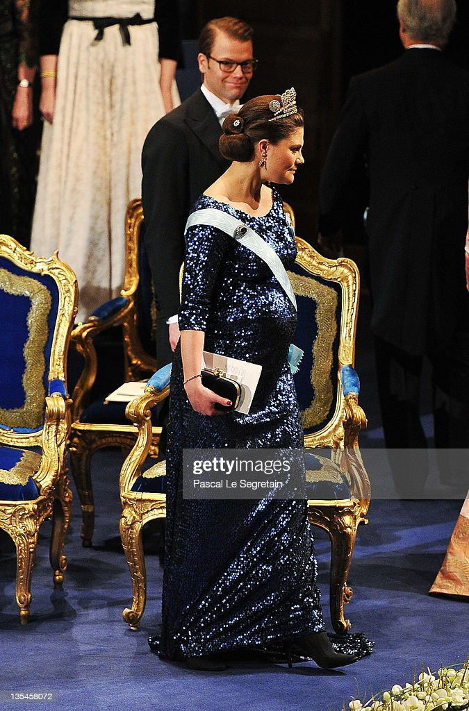 Prince Daniel of Sweden smiles as his pregnant wife, <a gi-track='captionPersonalityLinkClicked' href=/galleries/search?phrase=Crown+Princess+Victoria+of+Sweden&family=editorial&specificpeople=160266 ng-click='$event.stopPropagation()'>Crown Princess Victoria of Sweden</a>, at the Nobel Prize Award Ceremony 2011 at Stockholm Concert Hall on December 10, 2011 in Stockholm, Sweden.