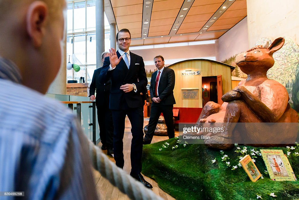 Prince Daniel of Sweden waves to four year old Pontus during the opening of the exhibition 'Frech, wild & wunderbar - schwedische Kinderbuchwelten' at the Swedish Embassy on April 11, 2016 in Berlin, Germany.