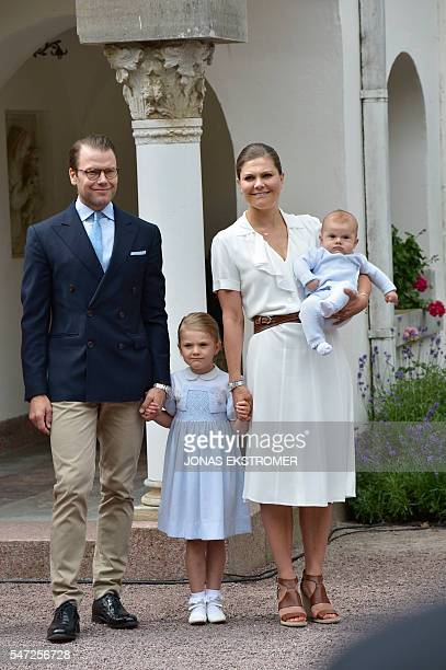 Prince Daniel Princess Estelle and Crownprincess Victoria of Sweden holding Prince Oscar greet the crowds gathered to celebrate the birthday of...