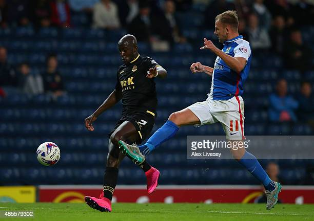 Prince DesireGouano of Bolton Wanderers competes with Jordan Rhodes of Blackburn Rovers for the ball during the Sky Bet Championship match between...