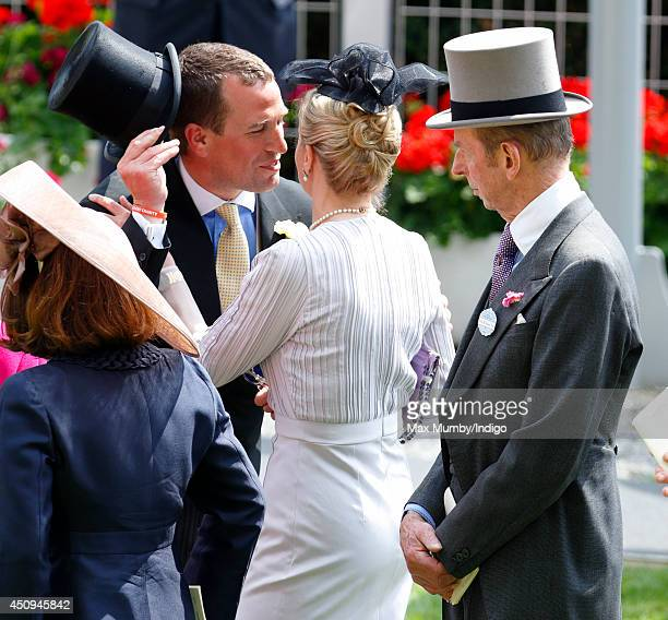 Prince Edward Duke of Kent looks on as Peter Phillips kisses Lady Helen Taylor on Day 4 of Royal Ascot at Ascot Racecourse on June 20 2014 in Ascot...
