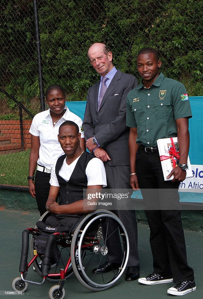 Prince Edward, Duke of Kent poses for a photo with Kgothatso Montjane (L), Lucas Sithole (C) and Evans Maripa during his visit to the Wheelchair Tennis Clinic at the University of Johannesburg on October 10, 2012 in Johannesburg, South Africa. The Duke of Kent, who is the President of the All England Lawn Tennis and Croquet Club, met players from across the country, including members of the South African 2012 Paralympic team.