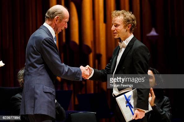 Prince Edward Duke of Kent presents Niklas Benjamin Hoffmann with his prize after winning the Donatella Flick LSO Conducting Competition at the...