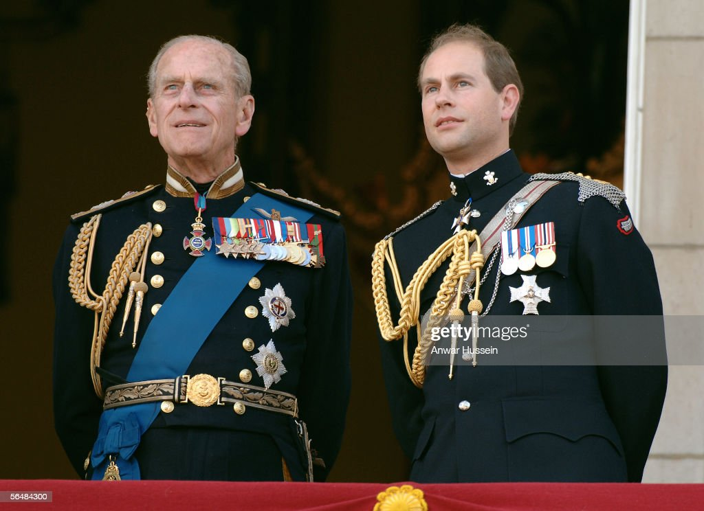 Prince Edward, Earl of Wessex and Prince Philp, Duke of Edinburgh watch the flypast over the Mall of British and US World War II aircraft from the balcony of Buckingham Palace on National Commemoration Day, July 10, 2005, in London, England.