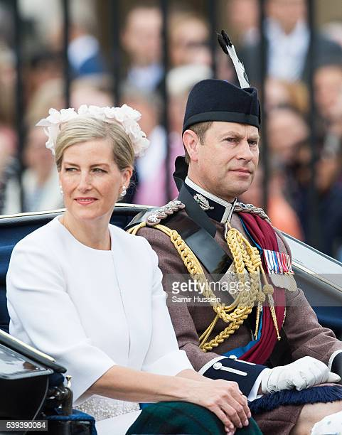 Prince Edward Earl of Wessex and Sophie Countess of Wessex ride by carriage during the Trooping the Colour this year marking the Queen's official...