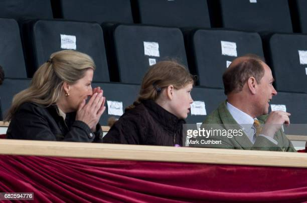 Prince Edward Earl of Wessex and Sophie Countess of Wessex with Lady Louise Windsor react as a rider falls off during a horse display in the main...