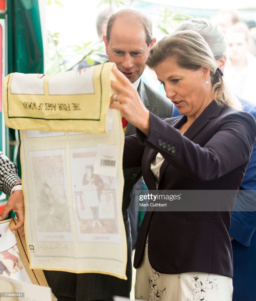 Prince Edward, Earl of Wessex and Sophie Rhys-Jones, Countess of Wessex study a funny tea towell during their visit to the New Forest and Hampshire county show at The Showground, New Park on July 31, 2013 in Brockenhurst, England.