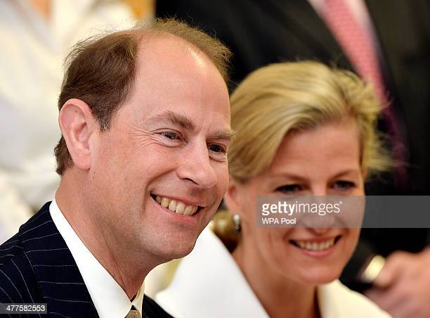 Prince Edward Earl of Wessex and the Sophie Countess of Wessex listen to pupils as they sit in a classroom during an official visit on the Earl's...