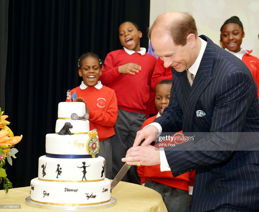 Prince Edward, Earl of Wessex cuts into a 50th birthday cake presented to him during an official visit on the Earl's 50th Birthday to Robert Browning Primary School in Walworth to see the work of youth charity Kidscape, recipients of grants from the Wessex Youth Trust, on March 10, 2014 in London, United Kingdom.