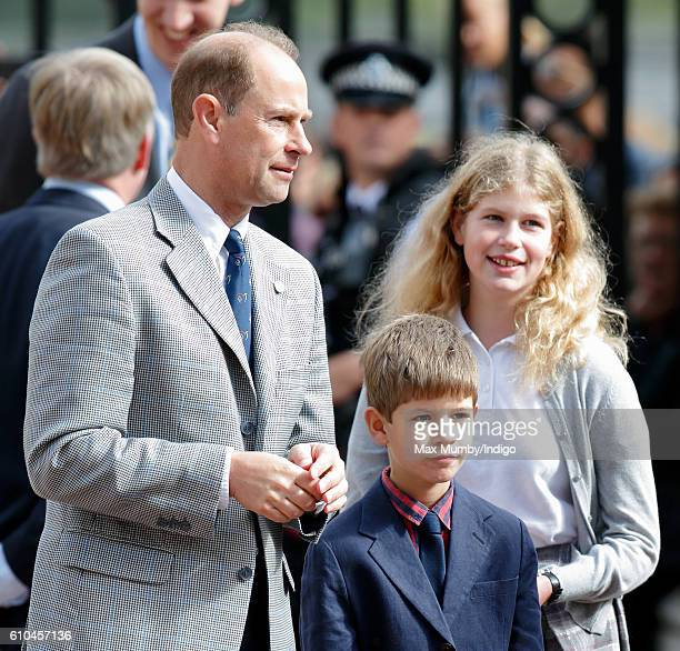 Prince Edward Earl of Wessex James Viscount Severn and Lady Louise Windsor await the arrival of Sophie Countess of Wessex at Buckingham Palace where...