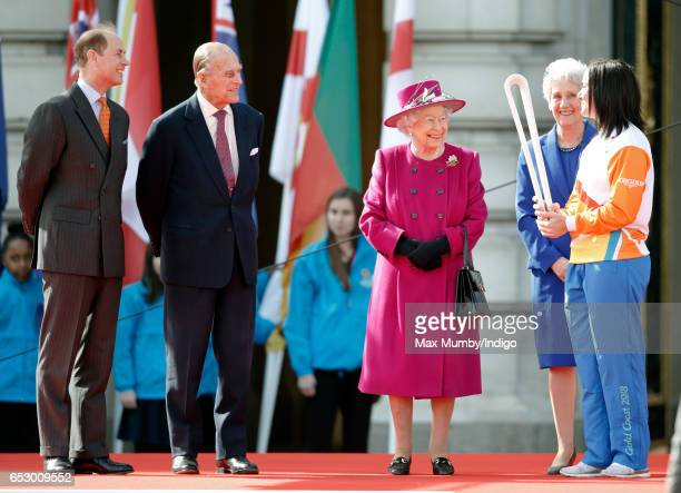 Prince Edward Earl of Wessex Prince Philip Duke of Edinburgh and Queen Elizabeth II look on as former track cyclist Anna Meares of Australia holds...